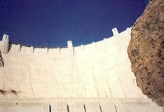 Dam.  Photograph of Hoover Dam in Nevada.  This icon denotes the dam portion of the name Dam-Atoll.  Title:  Lake Mead & Hoover Dam.  ©doncon402; doncon402 references a user_id on Flickr.  Used with their kind permission.  Flickr address:  http://www.flickr.com/photos/23437487@N00/371770943/  Flickr location:  http://farm1.static.flickr.com/145/371770943_cc4ae8e0cf_m.jpg